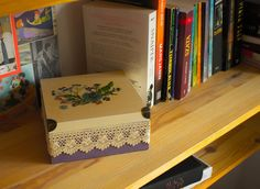 Decoupage wooden box with dried flowers.