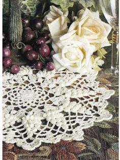 Symbolize the autumn harvest with this decorative doily ringed with grape clusters.Doily size: 12 inches (appx)Skill level: Intermediate