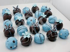Baby blue custom cake balls with butterflies  polkadots  and flowers