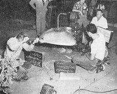 """The filming of the """"WAR OF THE WORLDS"""" movie requires a series of technical triumphs   in the model shop. Here, the operating mechanism of a heat‑ray that has to work practically is installed in a Martian flying wing."""