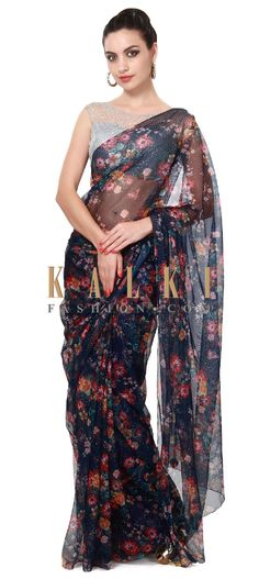 Buy Online from the link below. We ship worldwide (Free Shipping over US$100). Product SKU - 315826. Product Price - $149.00. Product Link - http://www.kalkifashion.com/navy-blue-printed-saree-matched-with-grey-blouse-only-on-kalki.html