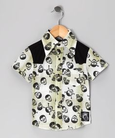 Fancied up from the buttons up, this shirt is hip and edgy thanks to a collar, cool plaid colors and sensational skull print.
