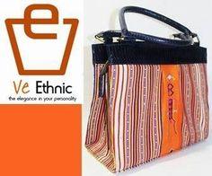 Batik Ria: Tas tenun dan kulit cobra