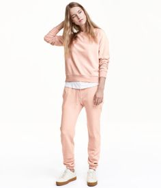 Powder pink. Sweatpants with ultra-slim legs, elasticized drawstring waistband, and side pockets. Elastication at hems. Brushed inside.