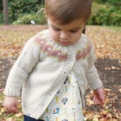 This is a printed pattern that requires shipping. This fair isle cardigan is worked flat from the top down. No steeking required! With sizes for toddlers through children, the adorable Sunset cardi be