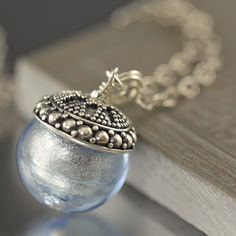 Light Blue round Venetian glass glass pendant necklace with sterling silver chain. $45.00