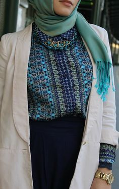 I love this outfit but I would style the hijab to drape over the bosom.