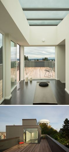 At the top of this modern house, there's a private yoga studio that opens up onto a rooftop deck with views of the neighborhood.