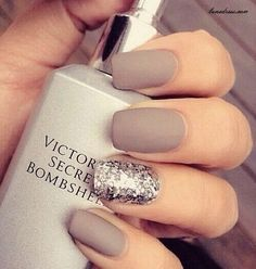 Matte beige nails with sparkle.
