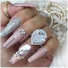 Rhinestone nails and bling bling.