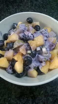 Finely chopped zucchini in blueberry cashew sauce with dried fruits and fresh fruits (blueberry, grape, honeydew melon)