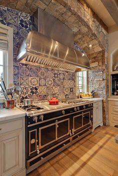 italian blue tiles backsplash black oven