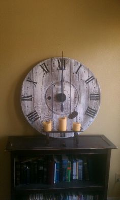 Clock made out of end of a cable spool.