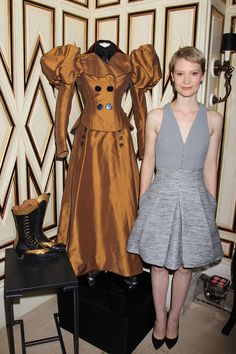 Mia Wasikowska at Bergdorf Goodman with one of her costume's from Crimson Peak, those boots are amazing!!