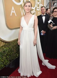 Anything goes: While Amy Schumer (L) picked a structured black and white gown, Saoirse Roan looked like a Grecian goddess
