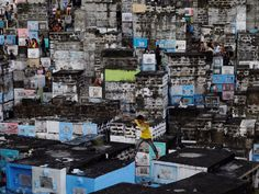 PHILIPPINES: A boy leaping between apartment-style tombs in the Barangka public cemetery as Filipinos visit the graves of their deceased loved ones to commemorate All Saints Day. Fotografia Social, All Saints Day, World Economic Forum, Countries Of The World, First Photo, Cemetery, Philippines, Times Square, Places To Go