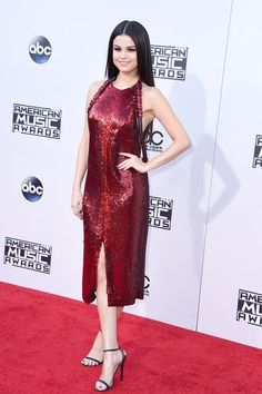 Selena Gomez in a Red Sparkly Low Back Givenchy Dress at the American Music Awards // See the Best and Worst Dressed from the 2015 AMAs: (http://www.racked.com/red-carpet/2015/11/22/9779748/2015-american-music-awards-best-dressed-worst-dressed#4885989)