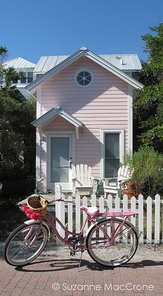 Faded pink is quickly becoming my favorite color;  faded pink cottage and retro bicycle.