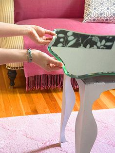 Designers David and Stacy made this posh cocktail table with inexpensive items from IKEA. They used the same style legs as desks in the living room (these are a shorter version at smaller cost -- only $7.50 each). Then they topped the table with a $30 bevel-edge mirror for an expensive look that didn?t drain the budget.
