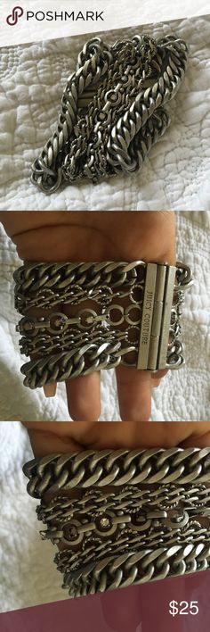 Juicy couture bracelet ONE DAY SALE 4/28/17🚨🚨🚨 Warrior looking juicy coutour bracelet, missing 2studs, can't tell when worn.m, would have to look closely. Pictures are fair to what bracelet looks like Juicy Couture Jewelry Bracelets
