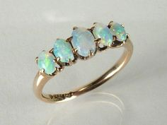 Vintage opal ring (I like the colour of the band, though the opals are a little bright)