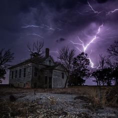 Dark Stormy Place - Lightning strikes close to an old school house near Beresford, South Dakota.