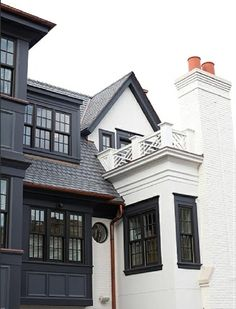 Painted Brick Houses: What Color to Paint the Brick. A custom color with a base of Benjamin Moore China White was used for the white trim and railings.