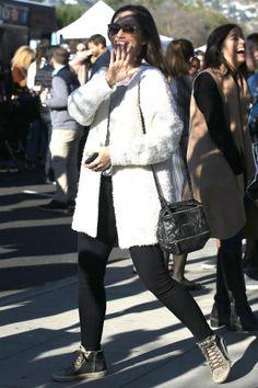 Minka Kelly wearing Givenchy Pandora Mini Bag in Black, Golden Goose Slide Sneakers, Garrett Leight California Optical Rialto Sunglasses and J Brand 620 Jeans in Seriously Black