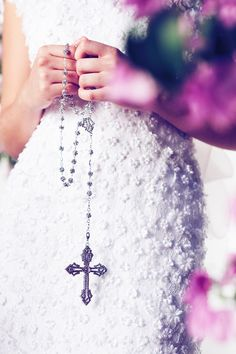 lovely.  her wedding dress fabric detail is stunning!!  catholic wedding rosary