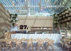 Inspirado no menu orgânico do Cafe 27, o escritório Four O Nine preencheu o prédio de vidro do restaurante com madeira e plantas suspensas.
