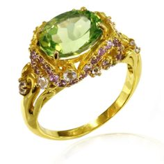 A gold plated ring with AAA Grade Peridots, Amethysts and White Topaz. The ring is made from the best quality 925 Sterling Silver and is crafted by our experienced craftsman to perfection. Sample the quality that we stand by with this ring, get it today!