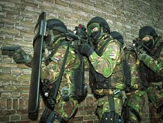 Dutch army commando's assigned to an STT - Special Tactic and Techniques - team, armed with the FN-Herstal P90 with silencer and protected by a bullet proof shield.