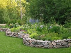 49 Outdoor Garden Decor Landscaping Flower Beds Ideas It's decidedly one of the preferred choices for those who would like to grow tiny trees with the intention of … Stone Raised Beds, Raised Garden Beds, Outdoor Garden Decor, Outdoor Gardens, Landscaping With Rocks, Backyard Landscaping, Farmhouse Landscaping, Landscaping Ideas, Stone Flower Beds
