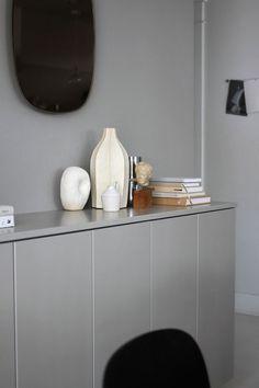 Grey palette in interiors; grey walls, grey furniture; monochromatic palette in interiors