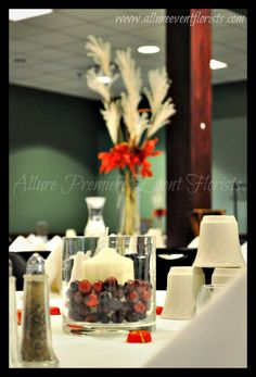 Cranberry candle centerpieces are complimented by tall pompus grass focal arrangements!