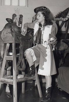 PRESERVING LEATHER - Ann Rutherford applies saddle soap to a saddle - Publicity Still.