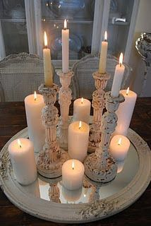 lovely grouping of candles and candlesticks - really makes a statement this way, perfect on the framed mirror