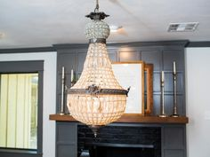 This antique style fixture was used as a unifying theme in several of the renovated spaces including the dining room, foyer and master suite.