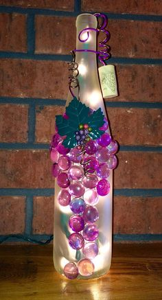 Like unusual and unique lighting? Need a great accent light for your kitchen or mantle? This pretty wine bottle light is embellished with beautiful