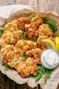 The cheese in these chicken fritters forms a crisp outer crust and a lovely cheese pull as you bite into these yummy chicken fritters. Juicy and delicious chicken patties!