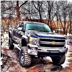 lifted black Chevrolet Silverado truck with