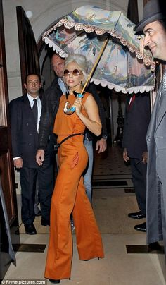 "Don't usually consider her ""classic beauty,"" but I actually love this Lady Gaga outfit, even the doorman in the grey suit!"