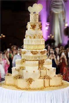 Huge, elaborate gold wedding cake.
