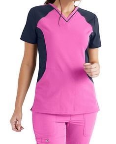 Stay fashion-forward with the stylish ELLE Color Block Top. Tonal fabric and three roomy pockets make this top a real winner. Shop for it exclusively at Uniform City. Cute Scrubs Uniform, Scrubs Outfit, Scrub Suit Design, Iranian Women Fashion, Medical Scrubs, Scrub Tops, Types Of Fashion Styles, V Neck Tops, Outfits