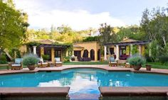 Pin for Later: Charlie Sheen Just Sold 1 of the 2 Beverly Hills Mansions He's Unloading  We're sure Charlie has thrown a party or two in the spacious backyard.