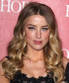 Amber Heard's Long Wavy full of body and volume. Try on this hairstyle and view styling steps! http://www.thehairstyler.com/hairstyles/formal/long/wavy/Amber-Heard-dainty-wavy-hairstyle
