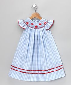 Charming crab embroidery scampers across the smocked neckline of this playful gingham dress. With adorable angel sleeves and rickrack trim, it's designed for creating cherished childhood memories. 55% cotton / 45% polyesterMachine wash; tumble dryMade in El Salvador