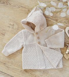 Knitting Pattern for Mayfair Lane Baby Coat With Hood - Baby hooded cardigan knit with double moss stitch in sport yarn. Sizes 6-12 months, 12-18 months, 18-24 months, 2 -3 years. Designed by OGE Designs