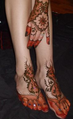 """Based on designs from """"Jewish Patterns from Kurdish Folk Art"""" by Alex Morgan The orange areas are henna that was only left on for about 15 minutes - the darker areas are henna, paste still on."""