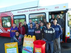 "Fraternities volunteering to ""stuff a bus"" with MTS and the ASYMCA to support military families."
